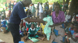 A beneficiary appreciating her donation